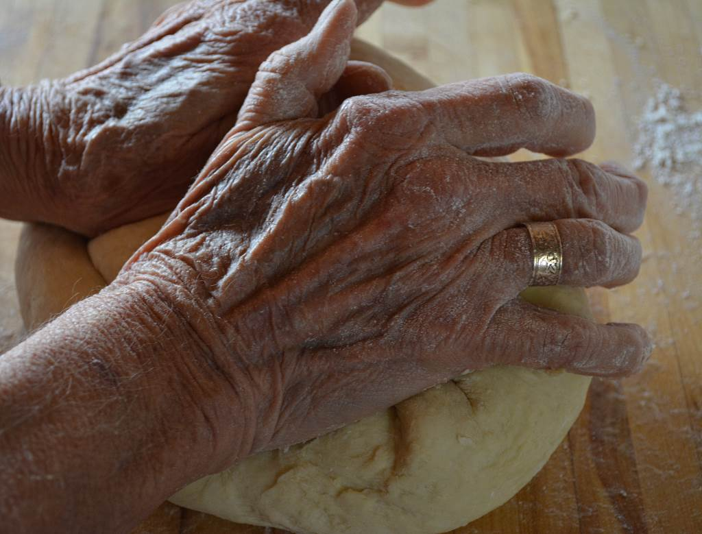 hands-kneading-dough